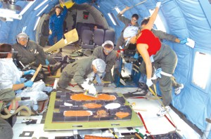 Researchers on board the KC-135 aircraft rehearse extravehicular activity tasks for repairing damaged shuttle tiles.