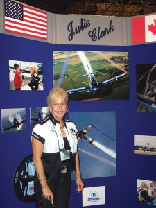"Julie Clark has performed at air shows for 25 years, winning many awards and honors in her 1956 Beechcraft T-34 ""Free Spirit"" marked in her creative version of ""Air Force One."""