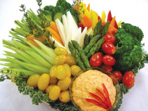 Corporate Air Services' menu features a colorful crudités tray stocked with fresh vegetables.