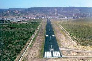 Final approach to Window Rock, Ariz., capital of the Navajo Nation. The fair is visible to the left of the runway.