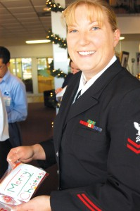 Cheri Flora, serving the Navy for 10 years, holds one of the 4,000 civilian rations in the form of holiday treats that were delivered to homesick soldiers during the holiday season.