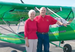 "Ron Lowery and Mary Walker take a few moments rest in front of ""Cloud Chaser,"" the custom-designed photo plane they flew 14,000 miles gathering photos and interviews for their book."