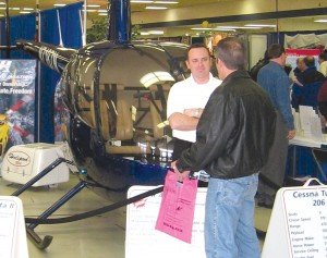 Hillsboro Aviation, sponsor of the 2005 event, brings a Robinson 44 into the Pavilion Hall.