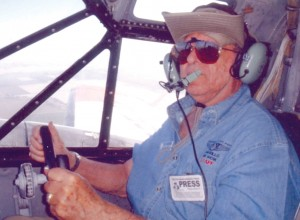 The Fred Baron in his Camarillo Air Show volunteer hat and shirt at the copilot controls of Twin Beech RC-45J during some fun maneuvers.