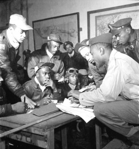 Tuskegee Airmen are briefed before a mission.