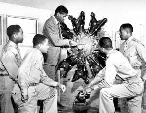 Members of the Tuskegee Airmen study an engine during training in Tuskegee, Ala.