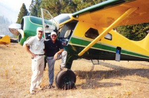 Greg Anderson, at the time executive vice president of EAA, visits with actor Harrison Ford during the Fourth Annual Backcountry Aerial Safari, in September 2003. In March 2004, Ford officially became chairman of EAA's Young Eagles program.