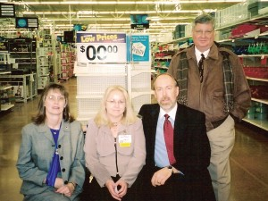 The city is pleased about Centennial's new Wal-Mart, which opened for business on January 26. City Councilwoman Susan Nix, Wal-Mart Store Manager Angie Acosta, Mayor Randy Pye and Wal-Mart Real Estate Manager Roger Thompson.