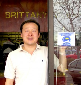 Ki Nam, owner of New Brittany Cleaners, 7562 South University Boulevard in Centennial, proudly displays his Centennial business sticker.