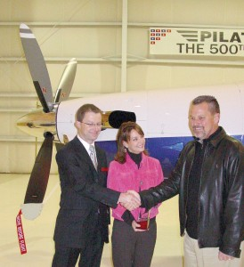 Thomas Bosshard, CEO of Pilatus Business Aircraft, congratulates Scott Archer and his wife Carol on their purchase of Pilatus' 500th PC-12.