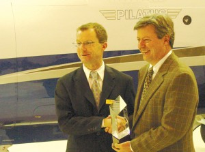 Dave Domenico (R), president of Centennial Airport-based Aviation Sales, Inc., one of the top-performing Pilatus dealerships in the northern hemisphere, receives an award from Pilatus CEO Thomas Bosshard.