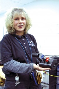 Lisa Neifert can change out the controls for a single or multiengine airplane aircraft simulation. Here, she holds the throttle quadrants for a single-engine airplane.