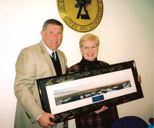 Centennial Airport Director Robert Olislagers presented outgoing Arapahoe County Commissioner Marie Mackenzie with a panoramic photo of the airport.