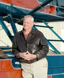 Pat Wiesner, founder of Wiesner Publishing, in front of his Centennial Airport-based de Havilland Beaver.