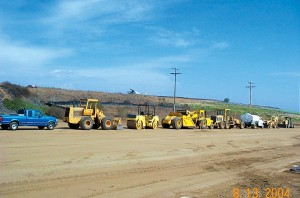 Work at the airpark required graders, concrete pumpers and numerous other pieces of heavy equipment. Here, some of the equipment is lined up in preparation for hundreds of hours of grading and other work.