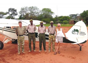 Pilots for the Kenya Wildlife Service pause during one of their training sessions with Patty Wagstaff as their flight instructor.
