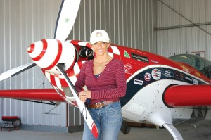 Patty Wagstaff in front of her Extra 300S at her hangar at  St. Augustine/St. Johns County Airport, where she bases Patty Wagstaff Air Shows.
