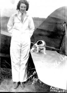 Dressed in her signature white jumpsuit, Faye Cox Rogers prepares to make her first parachute jump on April 30, 1930. Her first jump was also her first airplane ride.