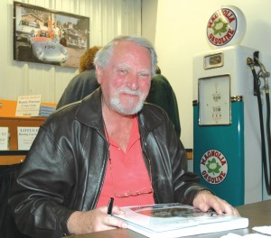 "Bestselling author Clive Cussler recently took time out from writing his own latest novel to sign copies of ""Wheels: A Passion for Collecting Cars,"" which features cars in his vast collection as well as others."