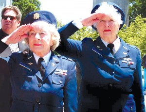 L to R: Former Women Airforce Service Pilots Lorraine Zillner Rodgers and Elaine D. Harmon salute during the playing of Taps at an Arlington National Cemetery ceremony honoring women service members.