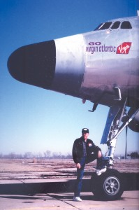 This Lockheed Constellation, a long time resident of the Salina Airport, received temporary nose art showing the owner's support for the Virgin Atlantic team. Its owner, Gordon Cole, is pictured with the Connie.