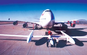L to R: Richard Branson, Steve Fossett and Salina Airport Manager Timothy Rogers with the GlobalFlyer in front of the Virgin Atlantic B-747 that transported the press and Virgin Atlantic team back to New York's JFK Airport.