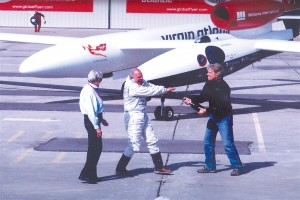 Sir Richard Branson, president and CEO of Virgin Atlantic Airways, sprays GlobalFlyer pilot Steve Fossett with champagne after his successful flight.