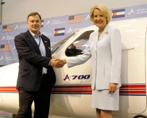 Rick Adam shakes hands with Colorado Lt. Gov. Jane Norton, in June 2004, during her visit to the company's headquarters at Centennial Airport. Adam Aircraft recently announced it will open a manufacturing and assembly operation in Ogden, Utah.