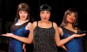 Lisa Payton, center, stars as Aretha Franklin with the Arethaettes, who are left, Sarah Rex, and right, Lindsay Okasaki.