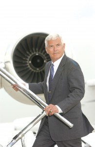 Bob Lutz boards a GM corporate jet at the GMATS terminal at Detroit Metropolitan Wayne County Airport.