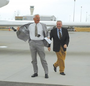 Bob Lutz flashes those gathered at Centennial Airport shortly before his takeoff. Airport Journals Publisher Jerry Lips is in the background.