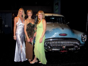 L to R: Princess Pamela Middelburg, Lady Jacqueline Porter and Denise Branditt attract attention to the 1953 Buick Roadmaster originally owned by Howard Hughes, which sold for $1.5 million.