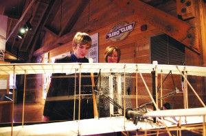 Janette and Keith Yoerg, the great-grandniece and great-great-grandnephew of the Wright brothers, admire a model of the Wright Flyer after the announcement at The Museum of Flight.