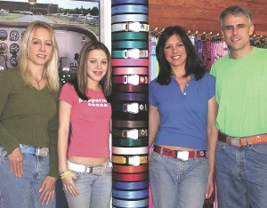 SkyBelts is a new entrepreneurial venture in Enumclaw, Wash., launched by Jennifer and Matt Longley (at right) and their daughter, Catherine Fagen. At left is office manager and friend Tina Mason with the SkyBelts display.