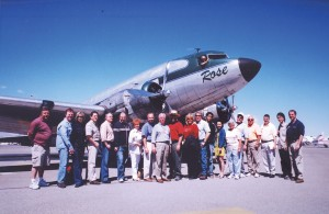 "One lucky group of passengers and crew pose with the DC-3, ""Rose,"" following their unique flight over the Las Vegas Strip."
