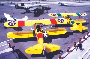 Two Stearman aircraft, a Waco and a B-25, all participants in the Las Vegas Centennial fly-by, are seen on display at the pre-event press conference held at North Las Vegas Airport.