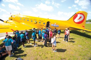 Wearing a brand new bright yellow paint job, and a smiley face, Duggy draws attention from youth, curious adults, and older veterans who either flew in a C-47 or crewed on one.