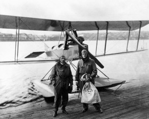 L to R: Eddie Hubbard and William Boeing with the Model C on the shores of Seattle's Lake Union following completion of the first international airmail flight, March 3, 1919. The mailbag Boeing is holding will be on display in the new Boeing exhibit.