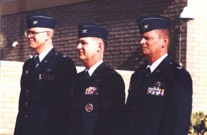 Outgoing commander Col. Curtis Papke (left) and the new commander, Col. Daniel Walker (center) stand at attention during the change-of-command ceremony.