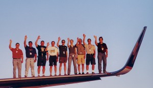 The AeroTEC flight test team on top of the 757's wing next to the 8 ft. 2 in. blended winglet.