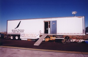 A trailer serves as a mobile flight test office for Aviation Partners Boeing and AeroTEC engineers and technicians