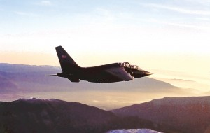 An Alpha Jet soars over Washington's Cascade Mountain range in early morning light on a training mission from Arlington