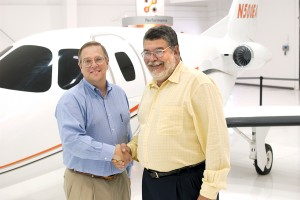L to R: Vern Raburn thanks Ed Iacobucci for his commitment to Eclipse Aviation.