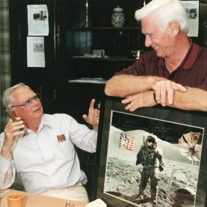 Gene Cernan, the last man to walk on the moon, shares a light moment with good friend and fellow aviator Barron Hilton, on one of Cernan's past trips to Hilton's Flying M Ranch.