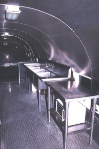 The immaculate commercial grade stainless steel kitchen.
