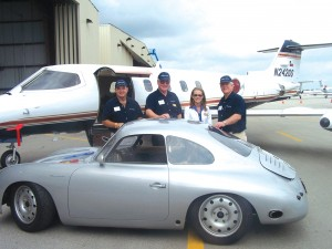 L to R: Jeff Hathorn, Roger Humiston, Chandra Stewart and Steve Woolstenhulme, of Best Jets, Ltd. and Best AeroNet Aviation, Ltd., show their Century 21 Learjet 25 next to a Porsche 356 highly modified for racing.