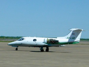 The Learjet 23, owned by the governor's office of the State of Mexico, sits on the ramp at Grayson County Airport as Best Jets technicians begin diagnostic tests on one of the engines.