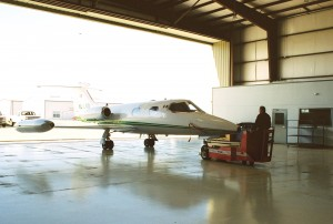 The Learjet 23 is brought into the flight line hangar for diagnostic testing and minor repair.