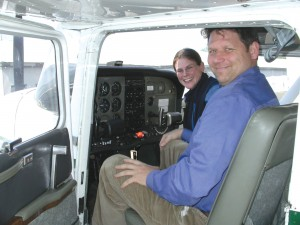 Christy Helgeson, assistant chief flight instructor at Wings Aloft, is teaching Rob Drake, a computer and flight instructor at Aviation High School, to fly. He hopes to qualify soon for his private pilot's license, joining a small group of deaf pilots.