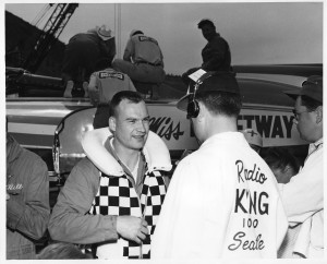 A KING-AM radio reporter interviews Brien Wygle after a race on Seattle's Lake Washington.